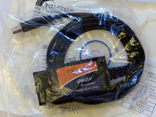Полученный OBD-II сканер и диск с драйверами